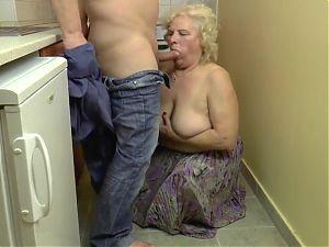 BBW blonde granny fucks in the kitchen
